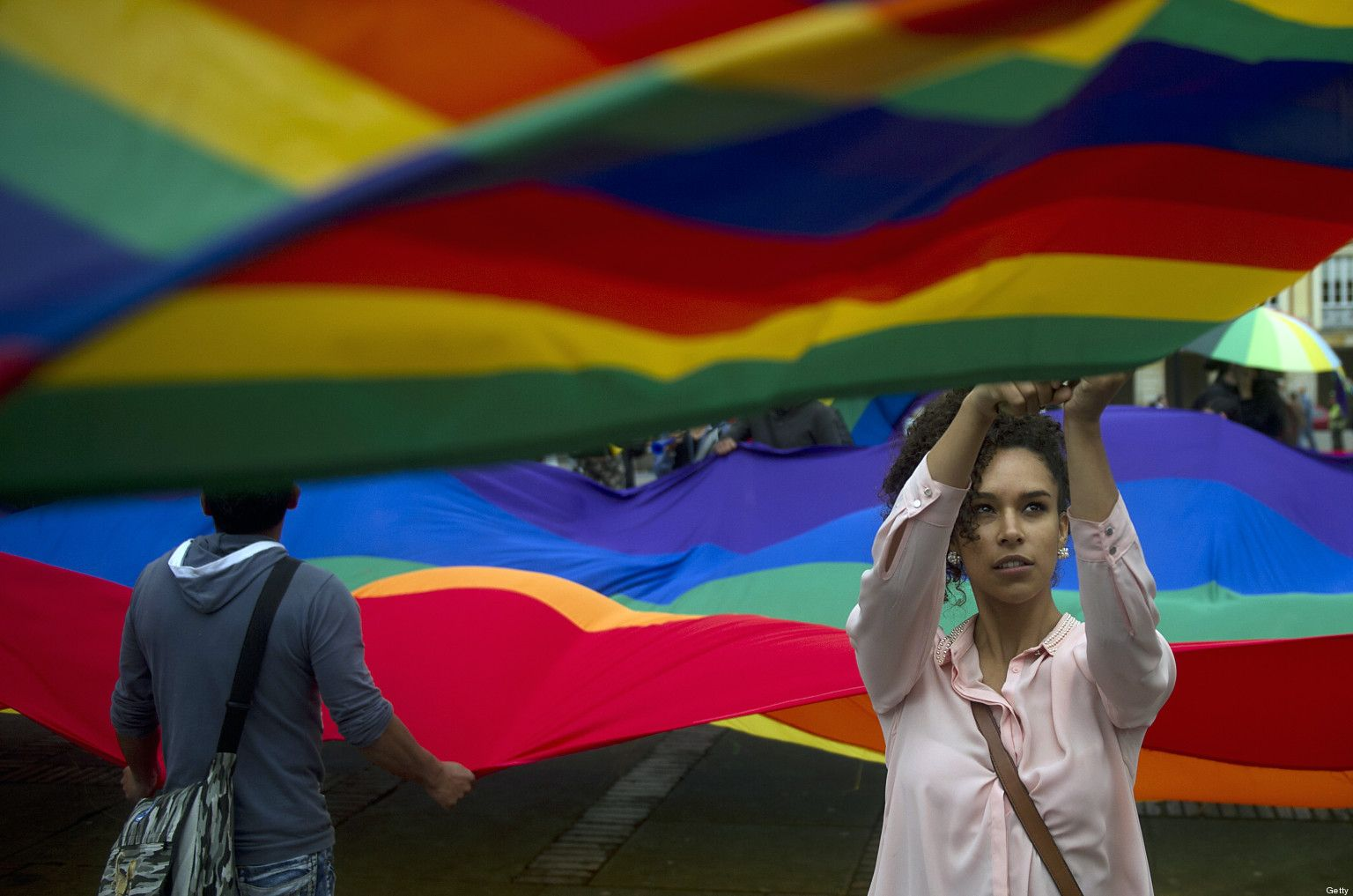 LGTB activists demonstrate outside the Colombian Congress in Bogota on April 23, 2013, at the time the Colombian Senate is to discuss the same-sex marriage bill. AFP PHOTO/Eitan Abramovich        (Photo credit should read EITAN ABRAMOVICH/AFP/Getty Images)