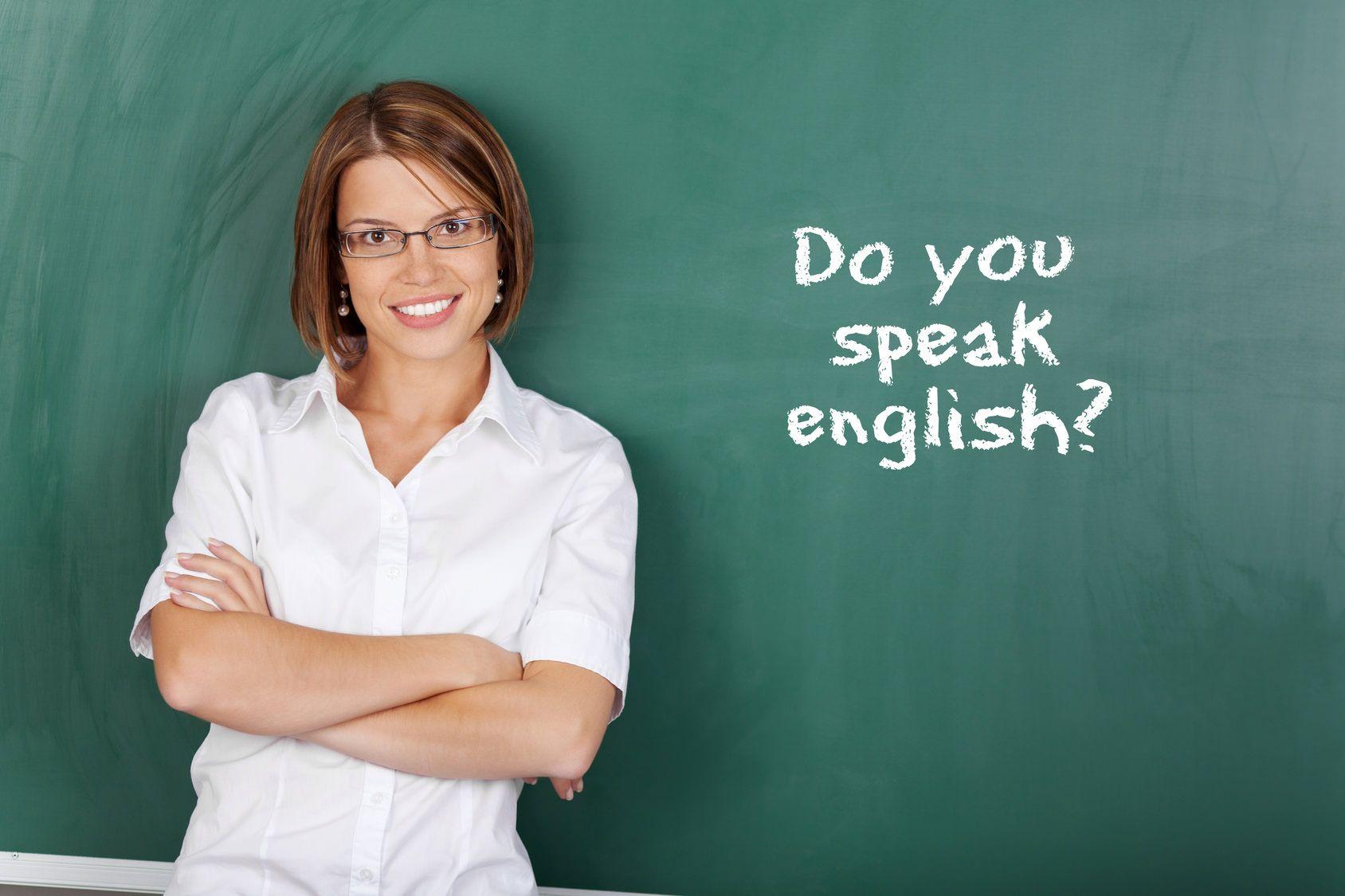Cheerful woman teaching English class at the classroom