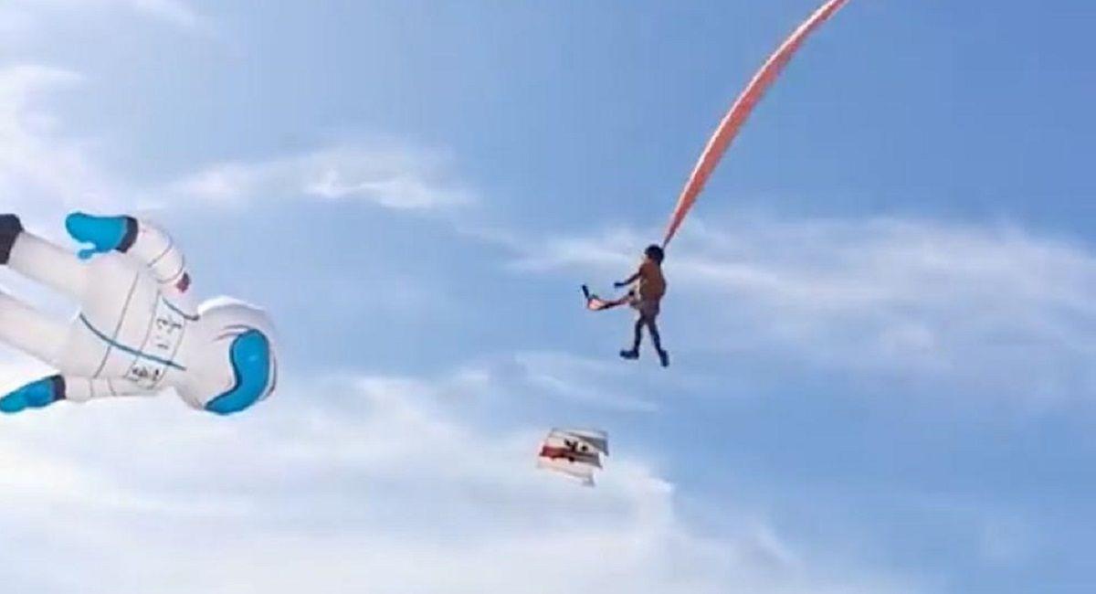niña volando cometa